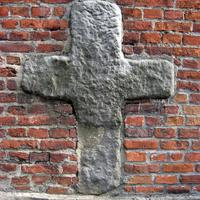 Romanesque cross on the north wall of St. Bartholomew's Church in Konin