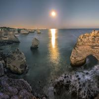 Sunset on the rocky cliffs and shoreline in Portugal