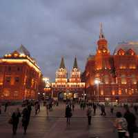People walking around the square at night in Moscow, Russia