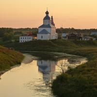 Landscape of church next to a river at dusk in Russia