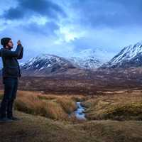 Man taking photo of the Majestic Mountains