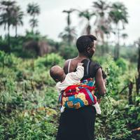 Mother Carrying Baby on Back in Sierra Leone