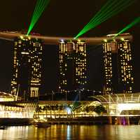 Laser Lights from the night towers in Singapore