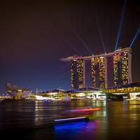 Triple towers and lights in cityscape of Singapore