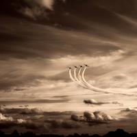 Three airplanes dancing in the sky