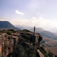 Person overlooking the landscape at Mkhomazi Wilderness area, South Africa