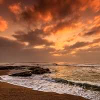 Seashore at dusk with waves and clouds in Nkwazi, South Africa