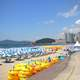 Beach with inner tubes and umbrellas in Busan, South Korea