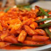 Tteokbokki, rice cakes with spicy gochujang sauce in South Korea