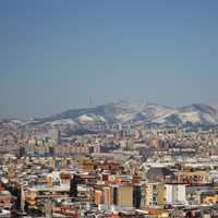Cityscape of Barcelona with the Mountains Behind