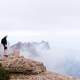 Man standing Landmark marker on the high mountains in Montserrat, Spain