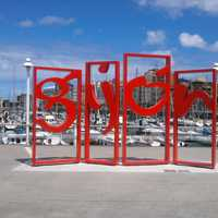 Modern piece of art with the city name in Gijon, Spain