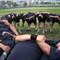 A team of Rugby players in a circle