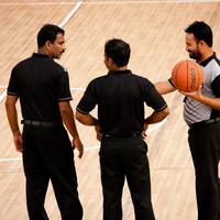 Basketball Referees on the court