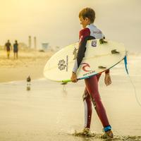Boy Surfer heading to shore