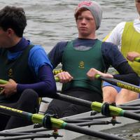 Boys in a team rowing