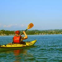 Canoer paddling on a lake