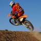 Dirt Biker jumping off a hill