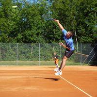 Man Hitting a Jump Shot in Tennis