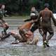Muddy Rugby Players