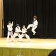 People performing Taekwondo on stage