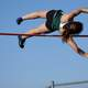 Woman Pole Vaulting over the bar