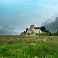 Castle on the end of a grassy field in Saint Moritz, Switzerland