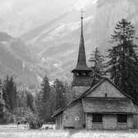 Church beneath the mountains in Switzerland