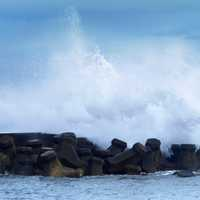 Waves crashing onto shore in Wanli Harbour in Taiwan