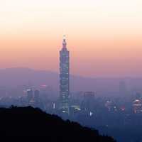 Taipei 101 at dusk under the reddish skies and haze in Taiwan