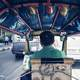 Man Driving a Cart in Bangkok, Thailand