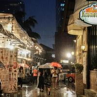 Rain at the night market in Bangkok, Thailand