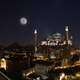 Night Cityscape in Istanbul, Turkey with moon and the Hagia Sophia