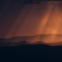 Red light shining down on hills in Ukraine