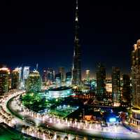 Dubai cityscape at night with Burj Khalifa in center in the United Arab Emirates - UAE
