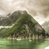 Black Clouds over rising hills in the Fjord around Juneau, Alaska