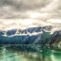 Landscape of mountains and Fjords under clouds around Juneau, Alaska