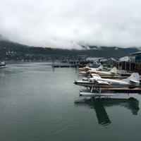 Planes in the Docks with Planes with cloudy sky in Juneau, Alaska
