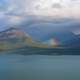 Rainbow coming out from the clouds in Lake Clark National Park