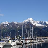 Boats in the harbor and Mountains in the Landscape in Seward, Alaska