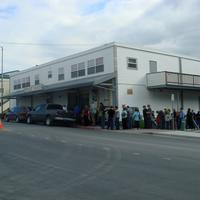 Customers line up in front of the Orpheum Theater in Kodiak, Alaska