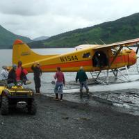 Floatplane dropping off Guests in the Wilderness near Kodiak, Alaska