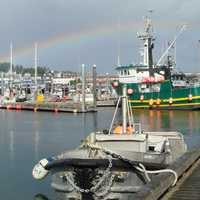 Kodiak Harbor, July 2009 with boats and a rainbow in Alaska
