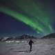 Man skiing under the aurora borealis