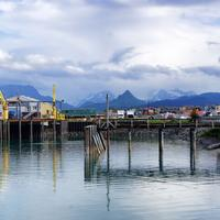 Town with Majestic Mountains in the Back in Alaska