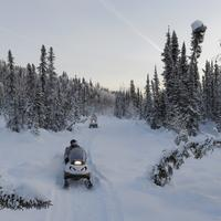 US Marines delivering toys for Tots on snowmobiles in McGrath, Alaska