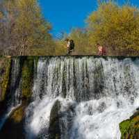 Old Fossil Creek Dam with fisherman on top