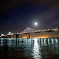 Moon and Stars over the Oakland-San Francisco Bay Bridge at night in California