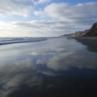 Black's Beach in California with clouds and water