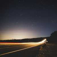 Lighted highway under the stars at Forest Hill Bridge, California